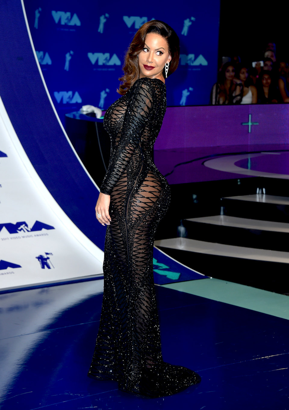 amber rose attended the 2017 vmas in a glamorous floor length dress with an almost entirely sheer fishnet style pattern