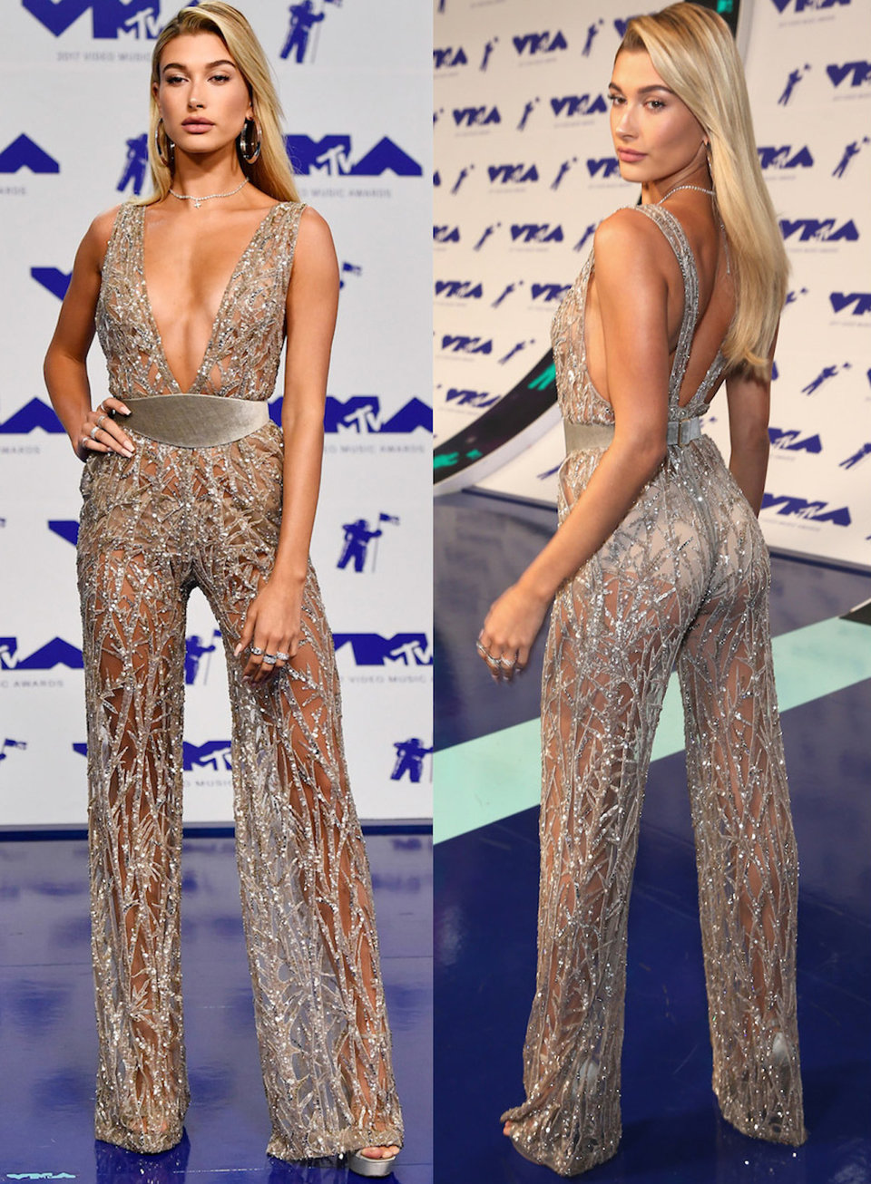 hailey baldwin wore a silver jumpsuit in a super thin material with a low v neck and wide velvet belt to the vmas in 2017