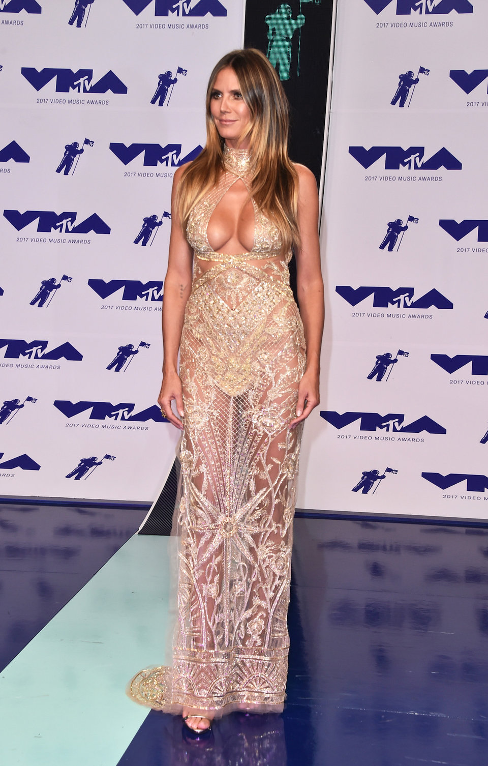 in 2017 heidi klum chose a semi sheer golden dress for her vmas outfit the fabric is so see through that in places it looks like it features cut out details