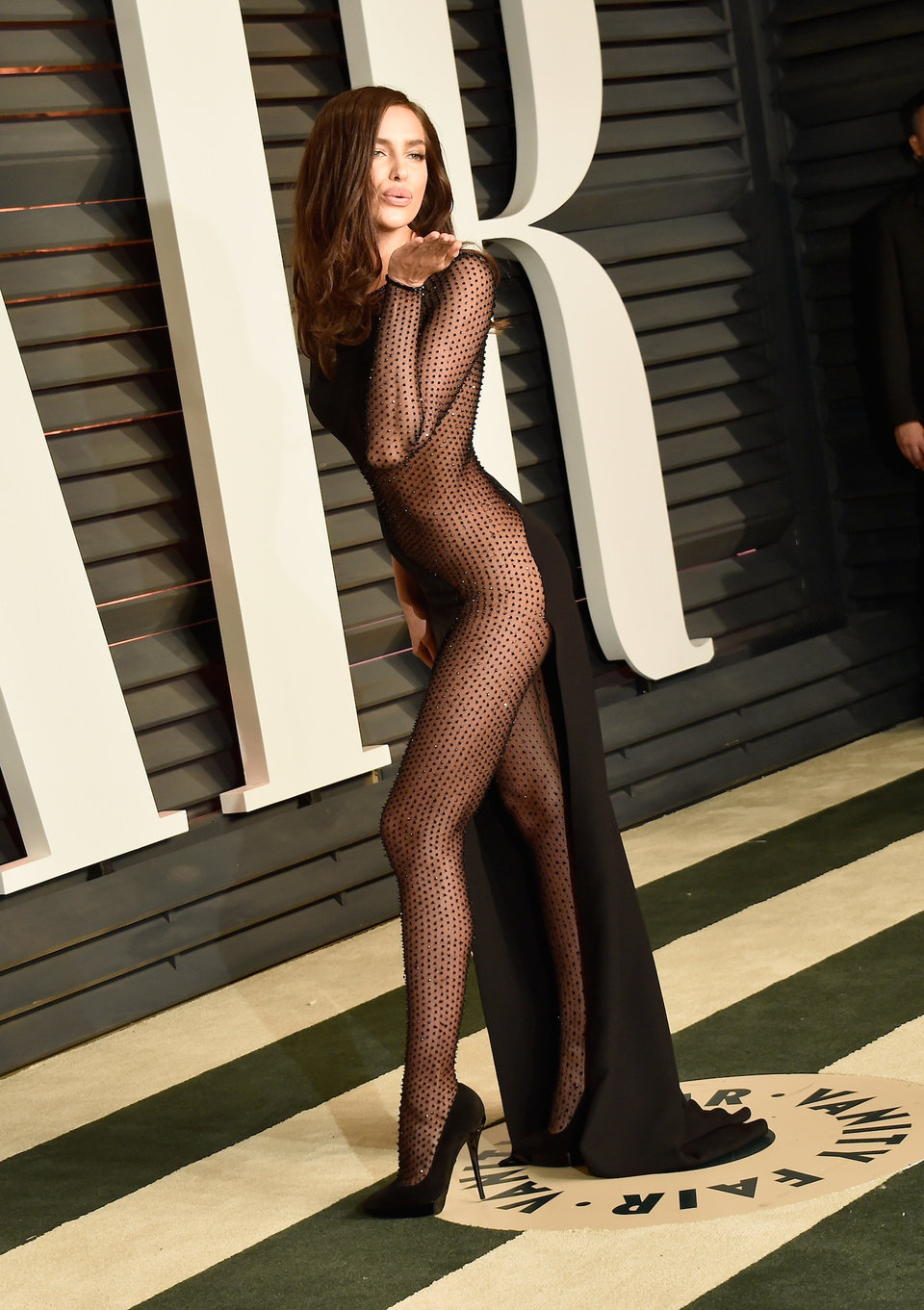 model irina shayk attended the same vanity fair event in an even more daring sheer dress