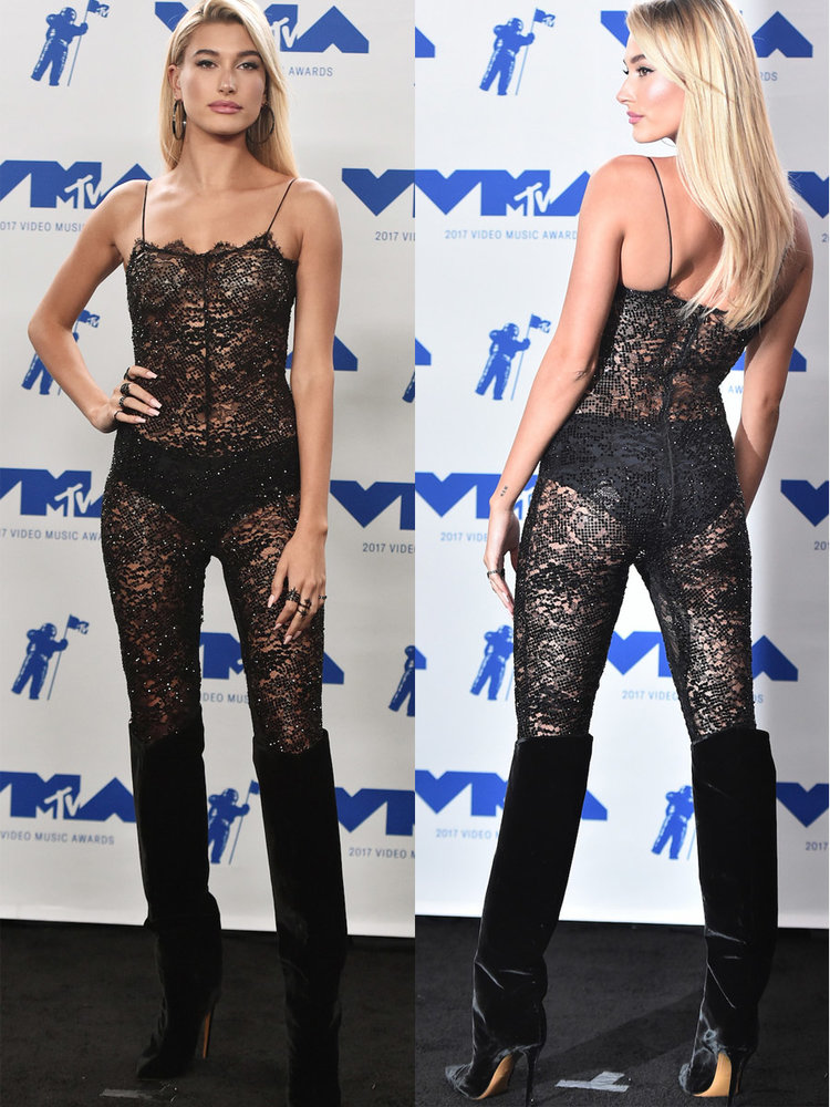 on the same night hailey baldwin wore a second see through jumpsuit this time in a black lace material with visible black underwear and a pair of knee high velvet boots
