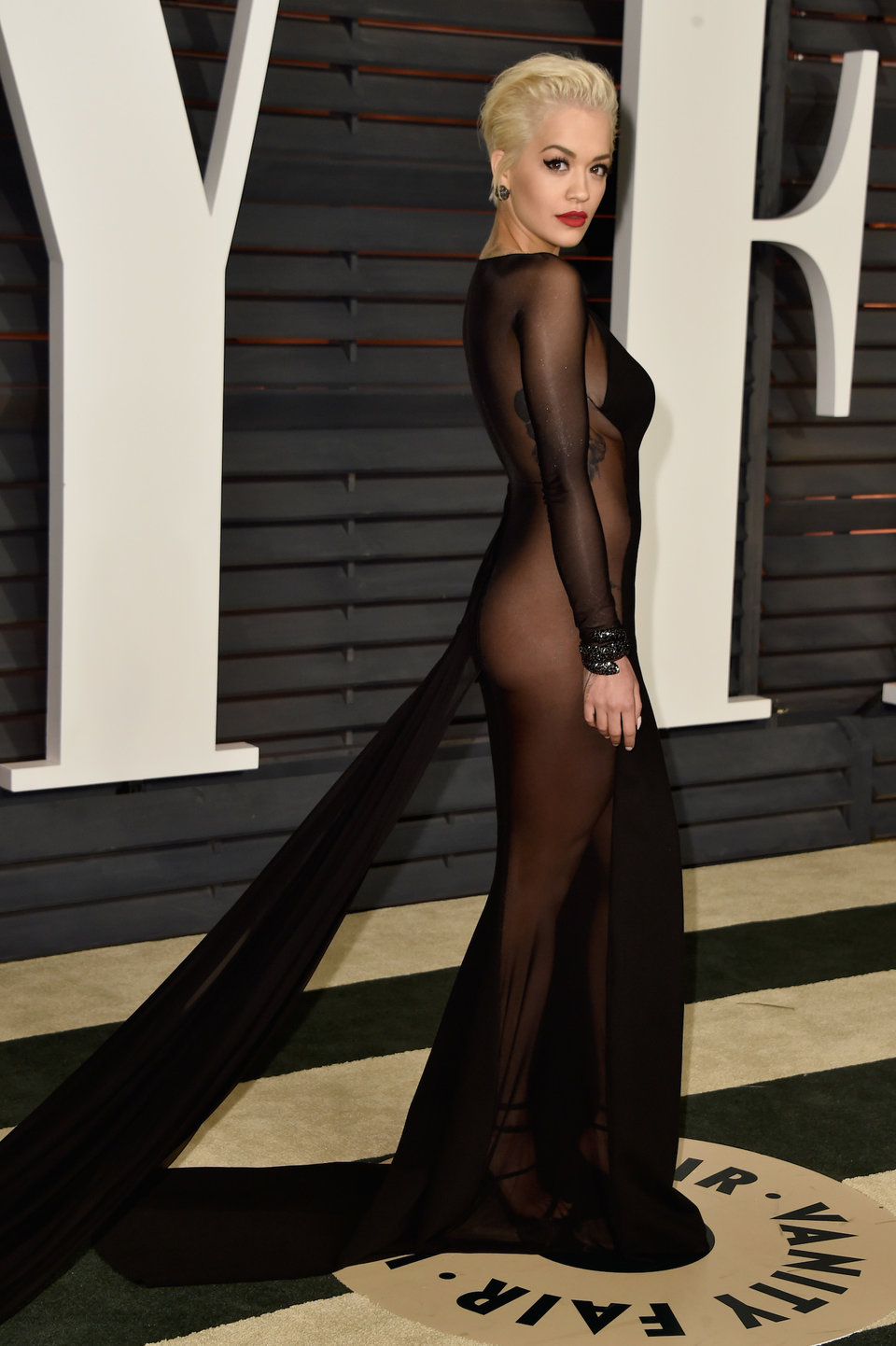 singer rita ora made waves at the 2015 vanity fair oscar party in her take on the black mesh gown