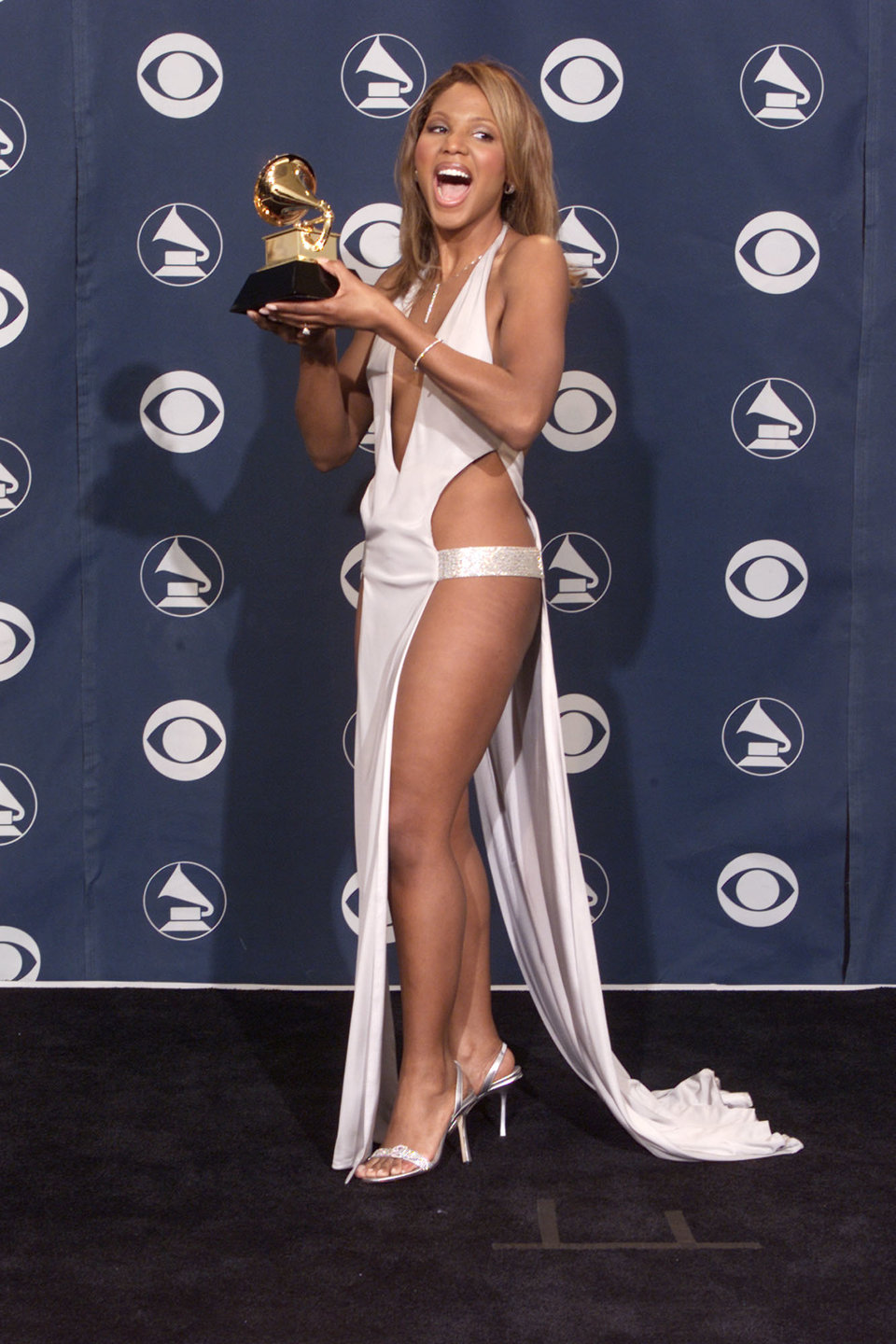 toni braxton broke the mold back in 2001 when she wore this white dress to the grammys