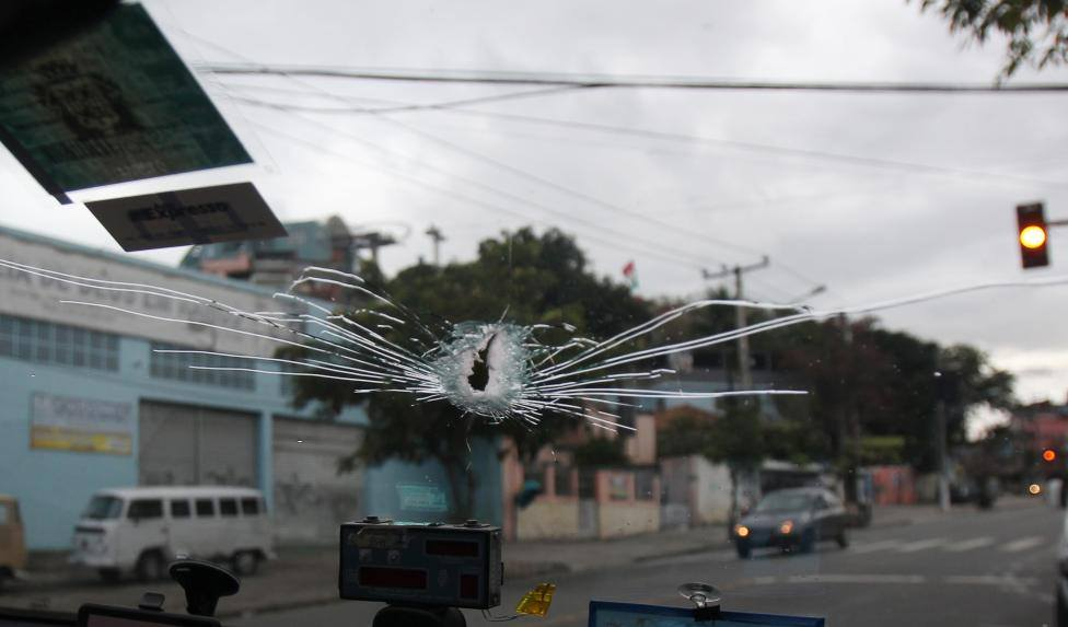 the window of a taxi is hit by a bullet as reuters