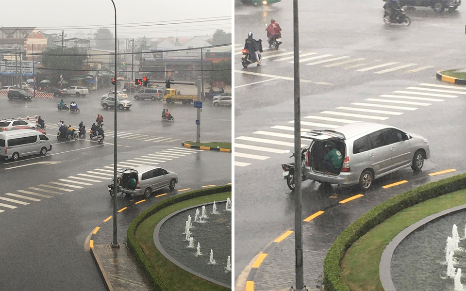 Góc đáng yêu: Bác tài ô tô mở cốp xe để tài xế Grab ngồi trú tạm giữa trời mưa to
