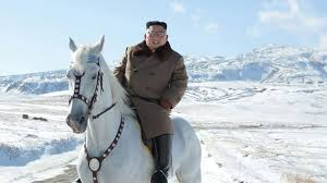 Kim Jong-un: North Korean leader rides horse up sacred mountain ...