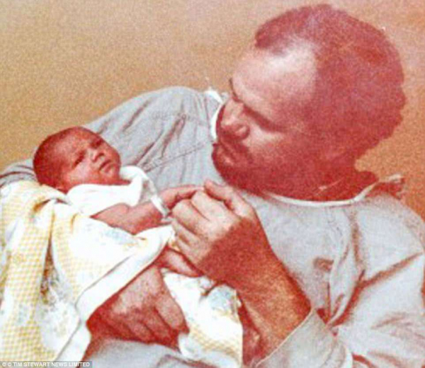 1981 its august 4 and in la tv lighting director thomas markle proudly holds his newborn child hand in hand with destiny