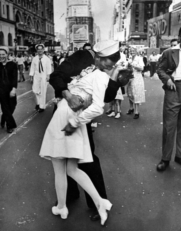 jubilant american sailor clutching a whiteuniformed nurse in a kiss picture id53366692 size1280