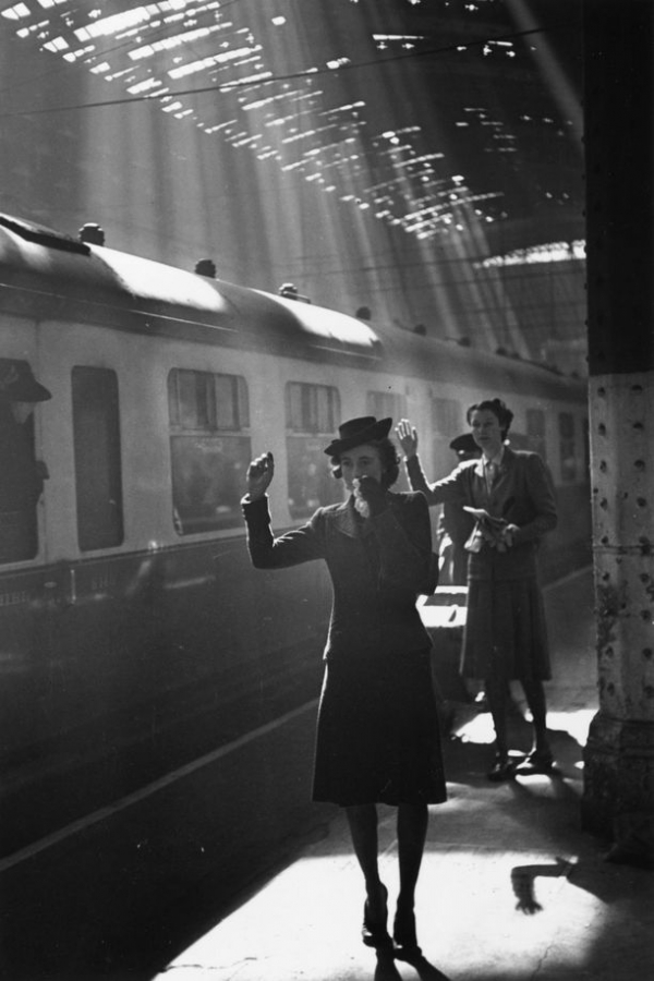 tearful wives waving goodbye as a troop train pulls out of a station picture id2667121 size612