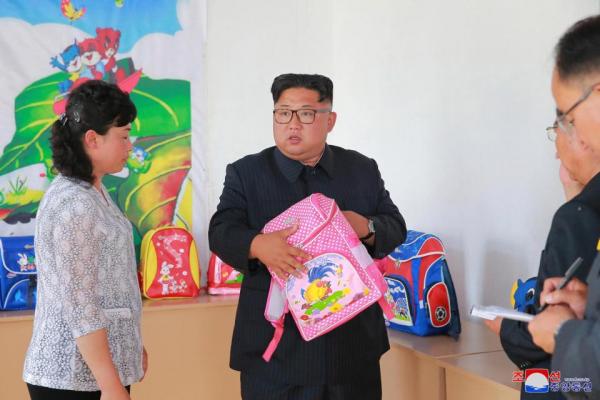 north korean leader kim checks out a kids rucksack at the chungjin bag factory