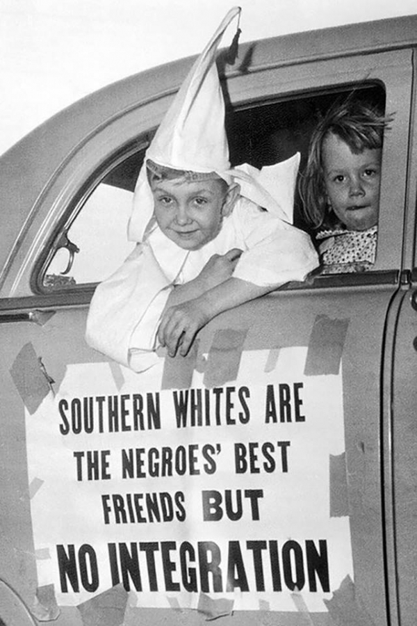 7 year old child wears a uniform of the klux klux klan in demonstration on april 14 1956 at the door of the car the poster southern whites are the best friends of blacks but integration no