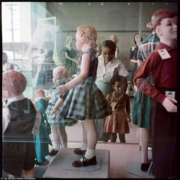 black girl watching white mannequins very different from today