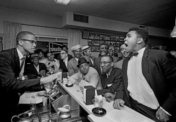 malcolm x and muhammad ali at a black bar in 1963