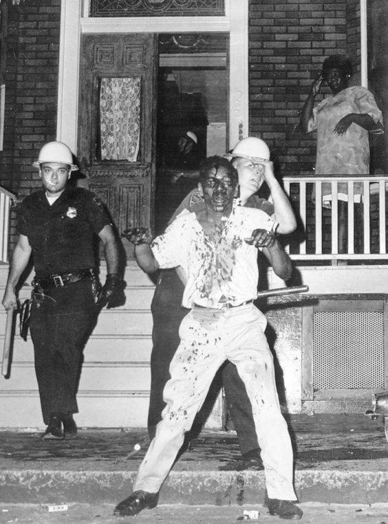 protester is beaten and immobilized by police officers new jersey 1967