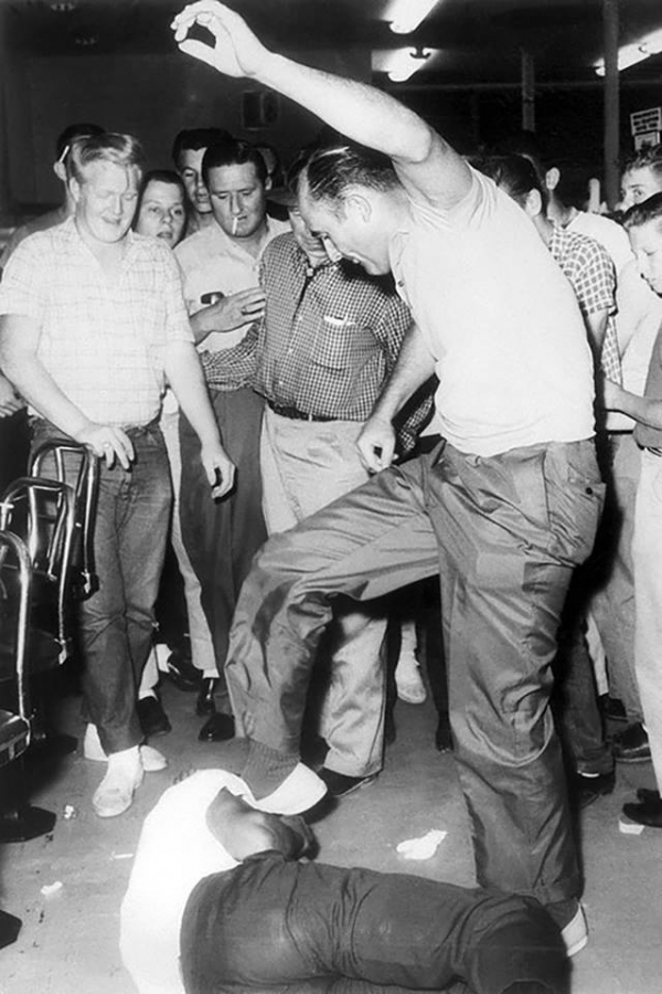 retired police officer benney oliver from jackson mississippi cruelly kicks memphis norman a black student who was waiting to be answered in a diner around white customers encourage beating