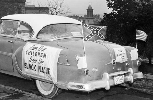 save our children from the black plague flag of the confederate states and the us quiver in car parked at capitol hill in nashville where then governor frank clemente met a delegation of supporters o