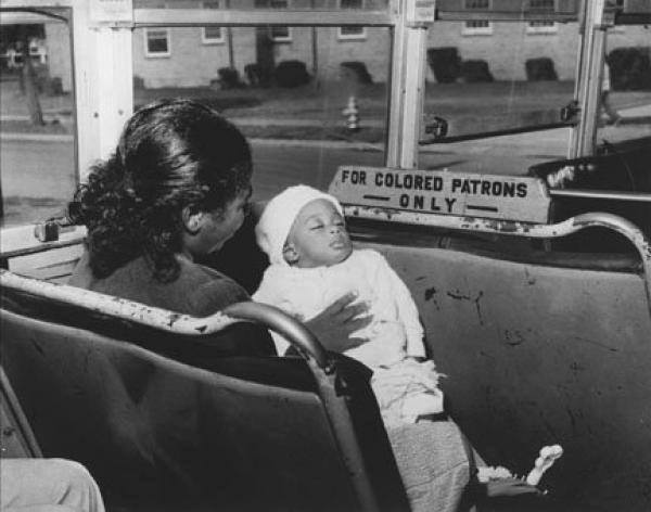 the mother and her baby in the part of the exclusive bus for blacks