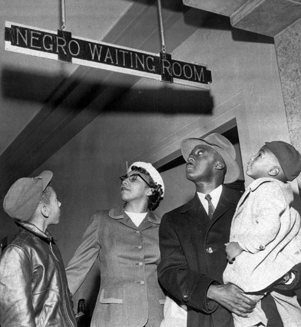 waiting room for blacks a couple of blacks and their children observe plaque at santa fe station in oklahoma city oklahoma on november 25 1955