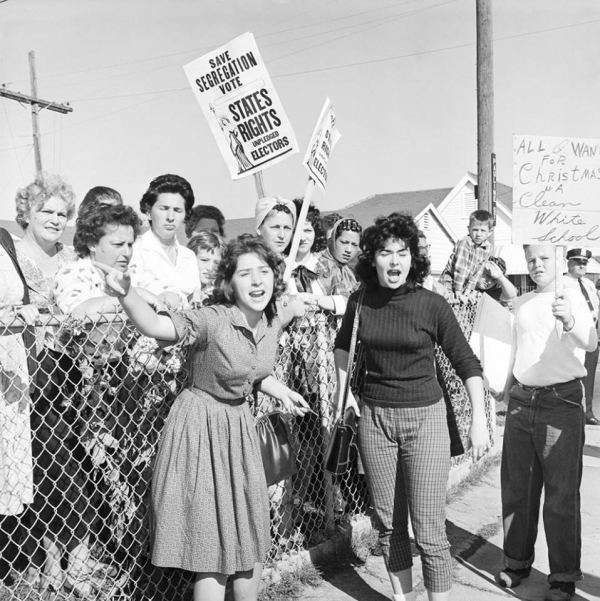 women protest in front of childrens school against racial integration
