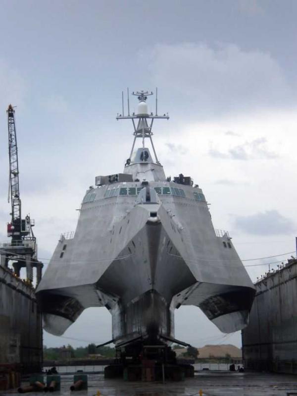 a modern battleship with no water around it