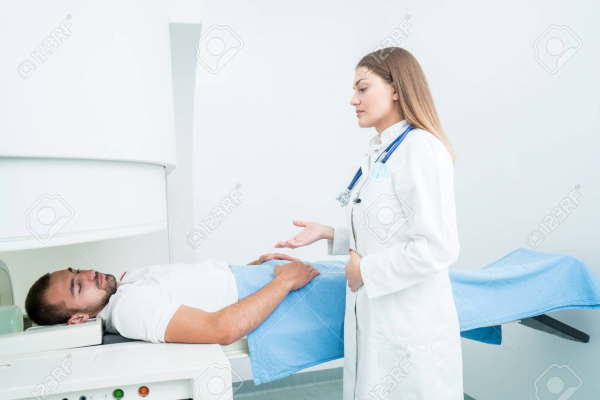 102210810 beautiful female doctor visiting male patient who is in bed
