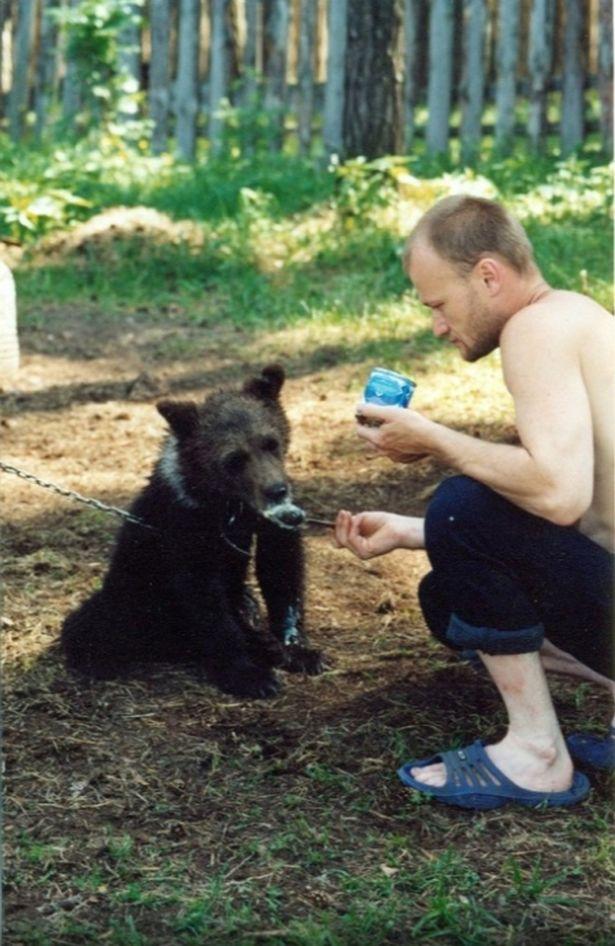 0 pay sergey grigoriyev with the bear cub 1 east2west