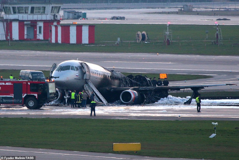 13139846 6996559 passengers scrambled to evacuate the jet after it made an emerge a 3 1557208011052