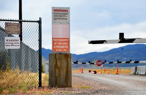 warning sign is posted at the back gate at the top secret news photo 1568225328
